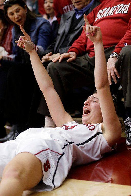 . Stanford \'s Toni Kokenis gestures after sinking a 3-point basket and being fouled by a Colorado player during the second half of an NCAA college basketball game in Stanford, Calif., Sunday, Jan. 27, 2013. Stanford won 69-56. (AP Photo/Marcio Jose Sanchez)