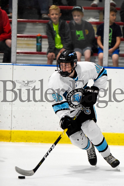 Harold Aughton/Butler Eagle: Seneca Valley Forward Kowin Belsterling, #88, pushes the puck down the ice in first period action.
