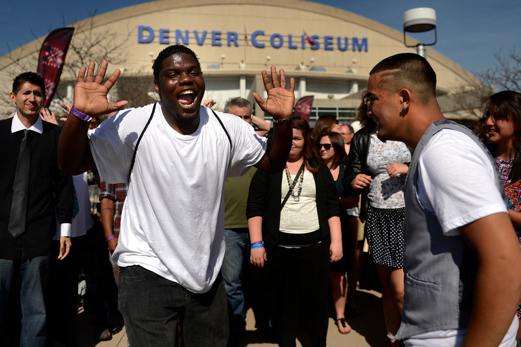 ". Kalan Nelson 20 of Denver and Jake Sheets 18 of Erie dancing for the cameras before going inside to take their chances on Fox\'s ""X-Factor\"" reality TV singing competition at the Denver Coliseum May 14, 2013 Denver, Colorado. (Photo By Joe Amon/The Denver Post)"