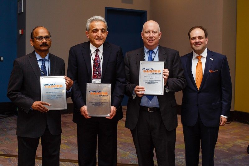 Thomas Roberts, Jr., MD, Chair of the Conquer Cancer Foundation, and recipients of the 2016 Clinical Trials Participation Awards during Clinical Trials Participation Awards