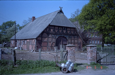 I came across this obviously old barn that has seen better times.  Note the wooden beam supports on the sides.