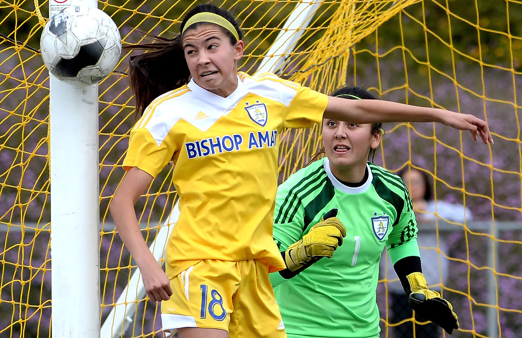. Bishop Amat\'s Alexis Rushlow (18) looks on along with goal keeper Evelyn Fierros (1) as Diamond Bar\'s Helena Kisor (not pictured) misses wide in the second half of a CIF-SS second round prep playoff soccer match at Diamond Bar High School in Diamond Bar, Calif., on Wednesday, Feb.26, 2014. Diamond Bar won 3-2. (Keith Birmingham Pasadena Star-News)