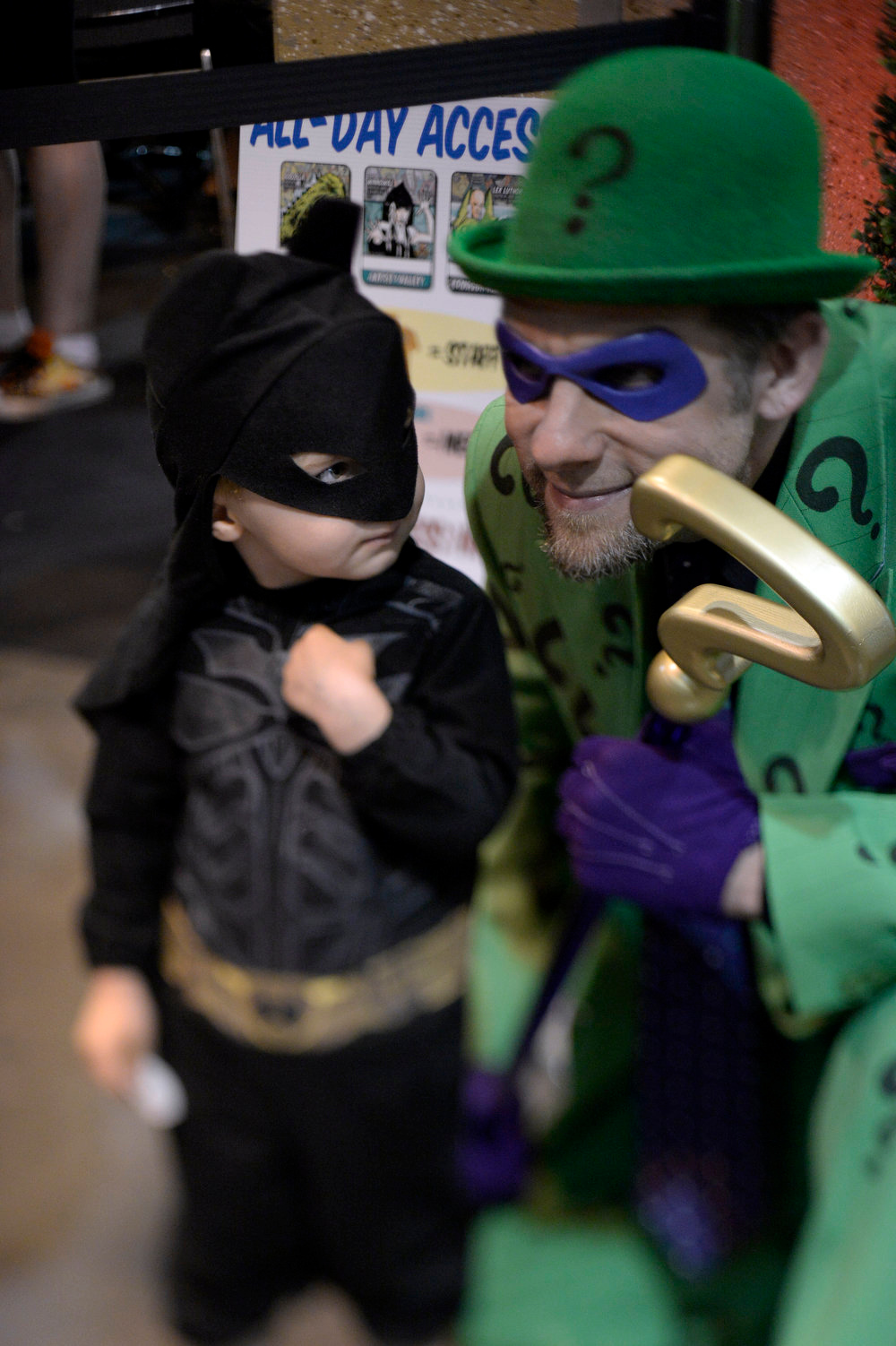 . Dom Roman-McKinney 2 1/2 years old as Batman poses for a photo with Stephen Kreutzer 41-years-old  as the Riddler as they attend the Denver Comic Con June 2, 2013 at the Colorado Convention Center. The Convention brought in more than 45,000 for the three day weekend. (Photo By John Leyba/The Denver Post)