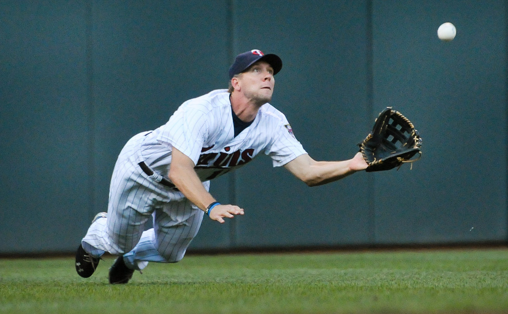 . Minnesota Twins center fielder Clete Thomas makes a diving catch for an out in the second inning as the Minnesota Twins play the Cleveland Indians at Target Field in Minneapolis, Minn., on Friday, July 19, 2013. (Pioneer Press: Ben Garvin)
