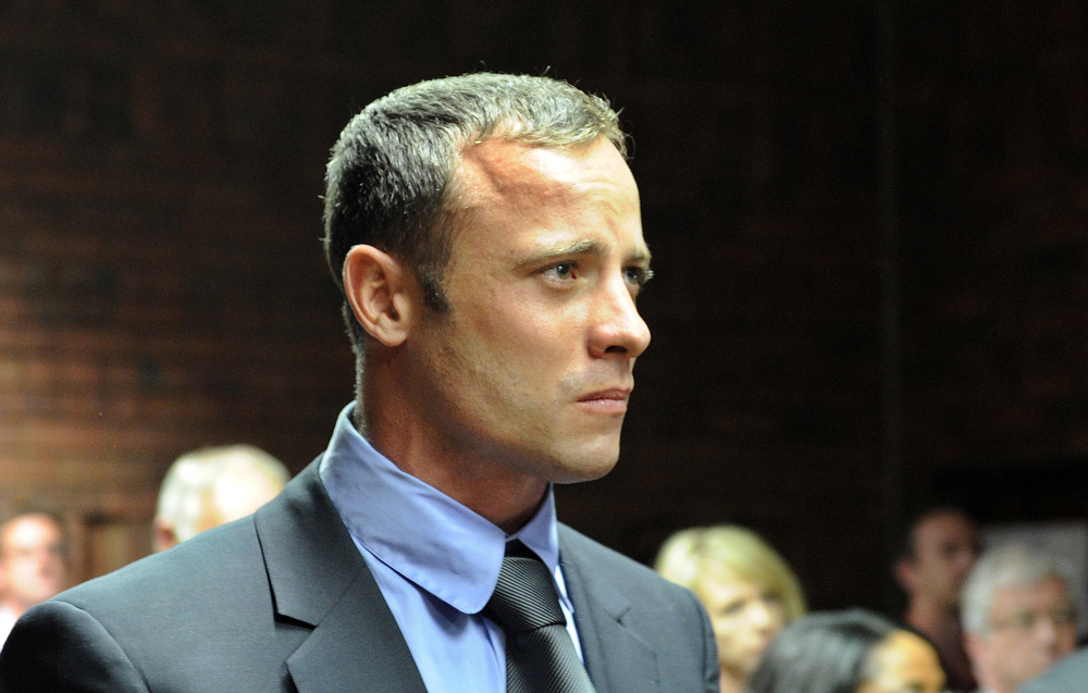 . South African Olympic sprinter Oscar Pistorius appears on February 19, 2013 at the Magistrate Court in Pretoria. Pistorius battled to secure bail as he appeared on charges of murdering his model girlfriend Reeva Steenkamp on February 14, Valentine\'s Day. South African prosecutors will argue that Pistorius is guilty of premeditated murder in Steenkamp\'s death, a charge which could carry a life sentence.  STEPHANE DE SAKUTIN/AFP/Getty Images