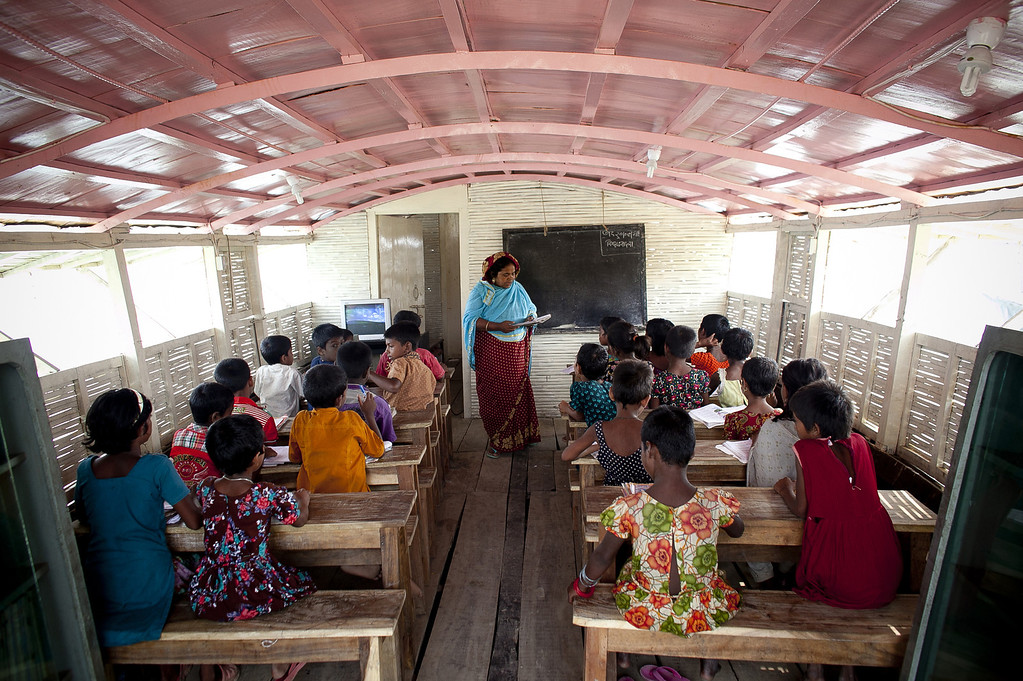 """. Children attend class in a  solar powered \""""floating school\"""" operated by Shidhulai Swanirvar Sangstha May 20, 2014 in Pabna district, Bangladesh.  (Photo by Allison Joyce/Getty Images)"""