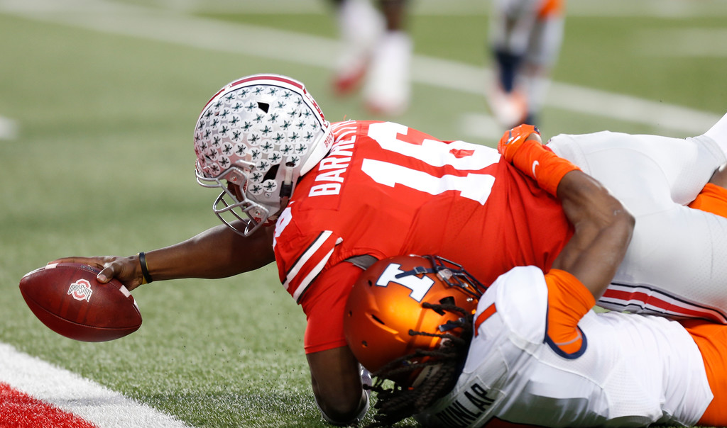 . Ohio State quarterback J.T. Barrett reaches across the goal line for a touchdown as Illinois defensive back Jaylen Dunlap tries to make the a tackle during the first half of an NCAA college football game Saturday, Nov. 18, 2017, in Columbus, Ohio. (AP Photo/Jay LaPrete)