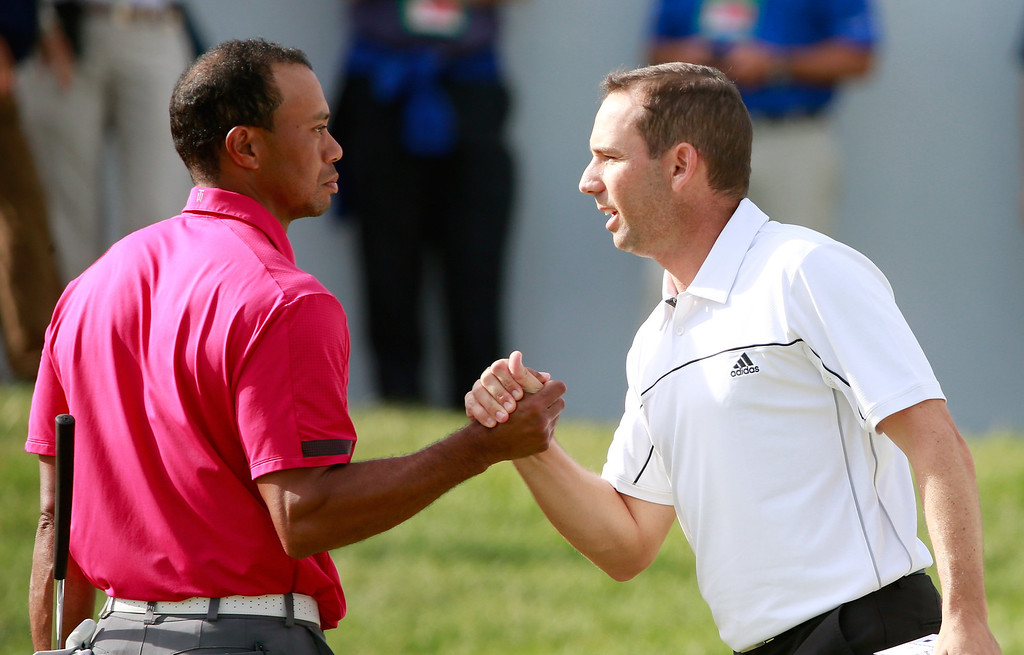 . LAKE FOREST, IL - SEPTEMBER 14: Tiger Woods (L) and Sergio Garcia of Spain shake hands on the 18th green during the Third Round of the BMW Championship at Conway Farms Golf Club on September 14, 2013 in Lake Forest, Illinois.  (Photo by Sam Greenwood/Getty Images)