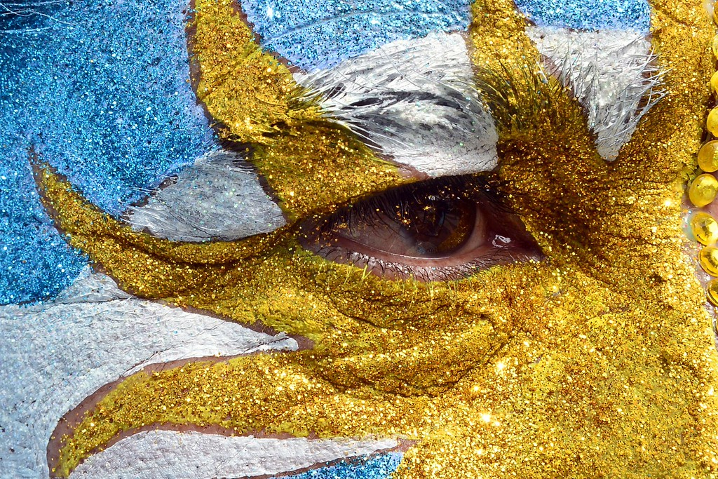 . An Argentina\'s fan with his face painted watches the Round of 16 football match between Argentina and Switzerland at Fan Fest in Copacabana beach in  Rio de Janeiro during the FIFA World Cup Brazil 2014 , on July 01 , 2014.  AFP PHOTO / GIUSEPPE  CACACE/AFP/Getty Images