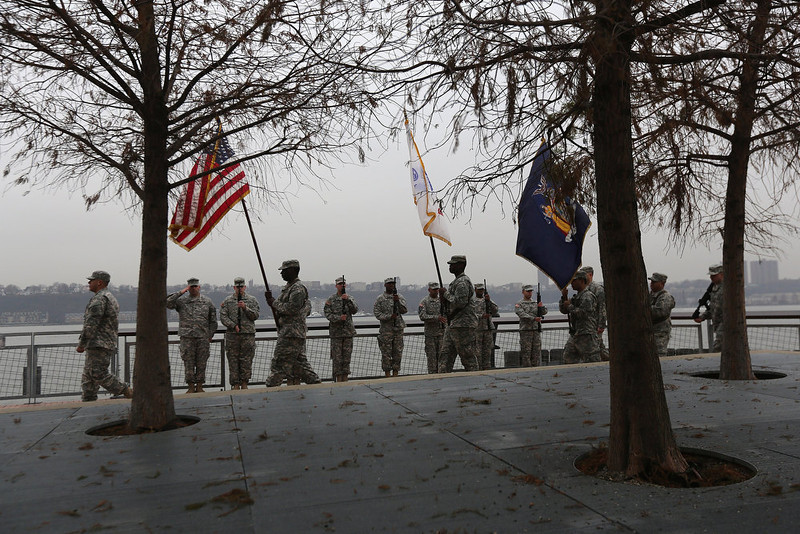 . An honor guard presents the colors during a ceremony commemorating the 71st anniversary of the Japanese attacks on Pearl Harbor on December 7, 2012 in New York City. Pearl Harbor survivors from the New York metropolitan area participated in a wreath-laying ceremony next to the Intrepid Sea, Air and Space Museum, which was closed due to damage sustained in Hurricane Sandy.  (Photo by John Moore/Getty Images)