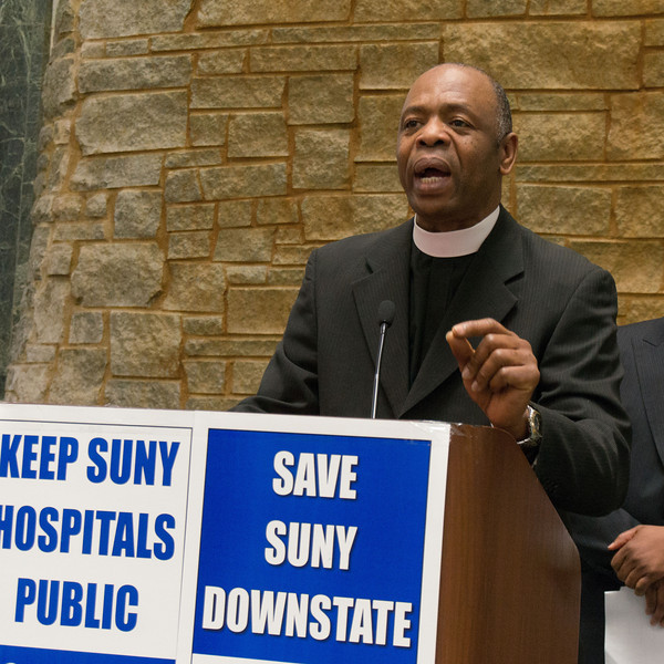 The coalition is led by members of Brooklyn's clergy. They've taken the lead in mobilizing their congregations to protest the layoffs and cutbacks. This pastor brought the crowd to its feet with a passionate call to action.