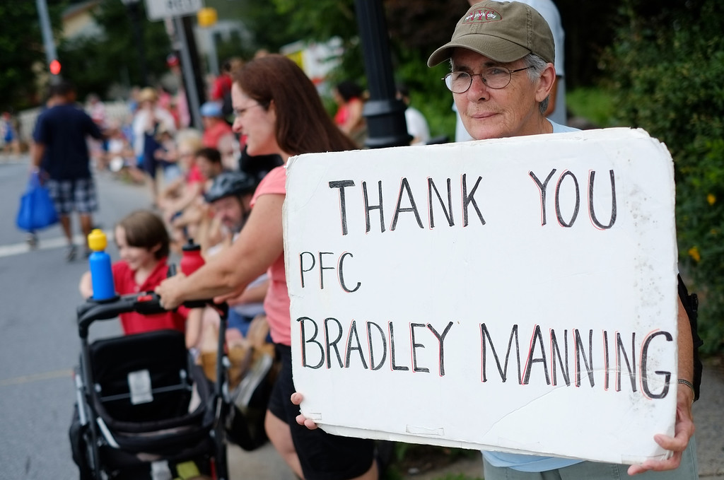 . A woman shows her support for Bradley Manning during the Independence Day parade in Takoma Park, Maryland on July 4, 2013. Independence Day celebrates the declaration of independence from Britain in 1776. Manning who sent war logs and State Department cables to WikiLeaks, is charged with 21 offences, including aiding the enemy.  MANDEL NGAN/AFP/Getty Images