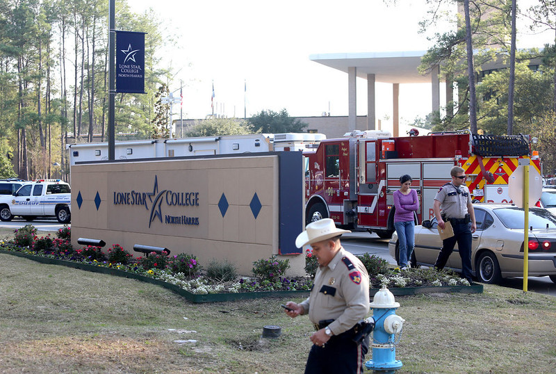 . Harris County Sheriff Officers work the scene at Lone Star Campus after a shooting occurred on January 22, 2013 in The Woodlands, Texas. According to reports, three people were injured during a shooting on the courtyard between the Library and cafeteria.  (Photo by Thomas B. Shea/Getty Images)