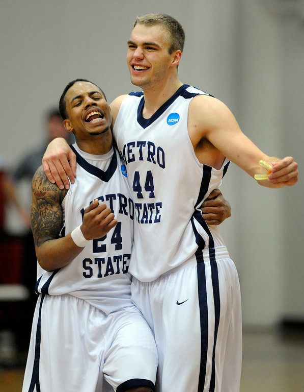 . DENVER, CO. - MARCH 19: Demetrius Miller (24) and Jonathan Morse (44) celebrated at the end of the game. The Metro State men\'s basketball team defeated St. Mary\'s (Texas) 78-70 in a RMAC playoff game Tuesday night, March 19, 2013. With the win the Roadrunners secured the South Central regional championship (Photo By Karl Gehring/The Denver Post)