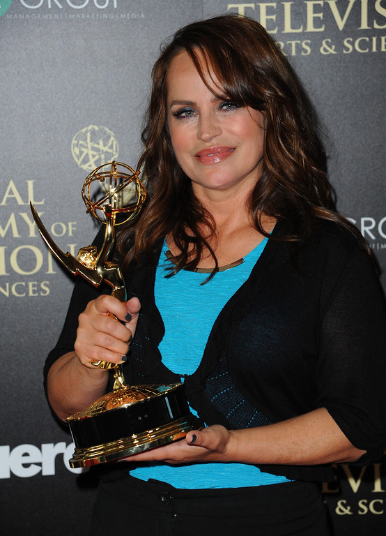 ". Crystal Chappell poses in the press room with the award for outstanding drama series new approaches for ""Venice The Series\"" at the 41st annual Daytime Emmy Awards at the Beverly Hilton Hotel on Sunday, June 22, 2014, in Beverly Hills, Calif. (Photo by Richard Shotwell/Invision/AP)"