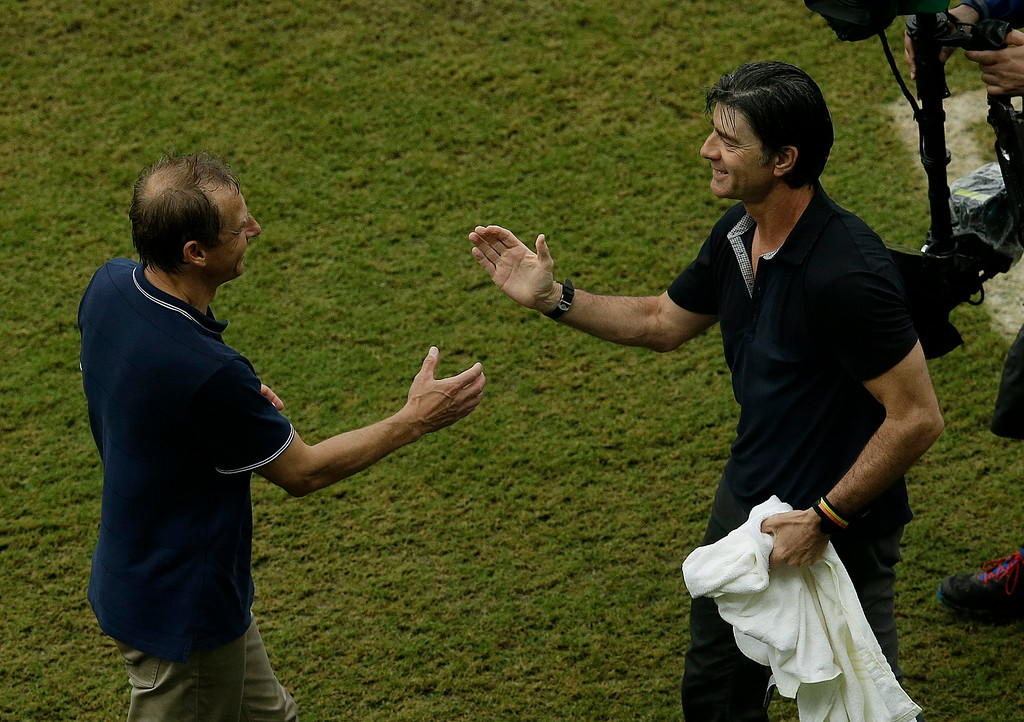 . United States\' head coach Juergen Klinsmann, left and Germany\'s head coach Joachim Loew greet each other after the group G World Cup soccer match between the USA and Germany at the Arena Pernambuco in Recife, Brazil, Thursday, June 26, 2014. Germany beat the United States 1-0. (AP Photo/Hassan Ammar)