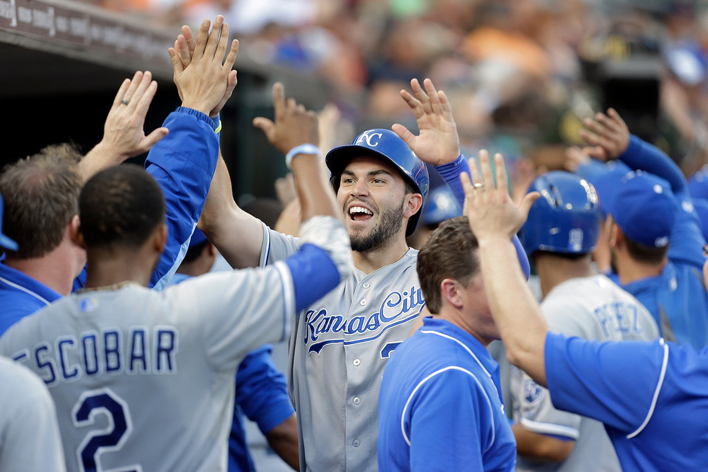 . Kansas City Royals\' Eric Hosmer celebrates with teammates after scoring on a Billy Butler three-run double in the fifth inning of a baseball game in Detroit, Monday, June 16, 2014.  (AP Photo/Paul Sancya)