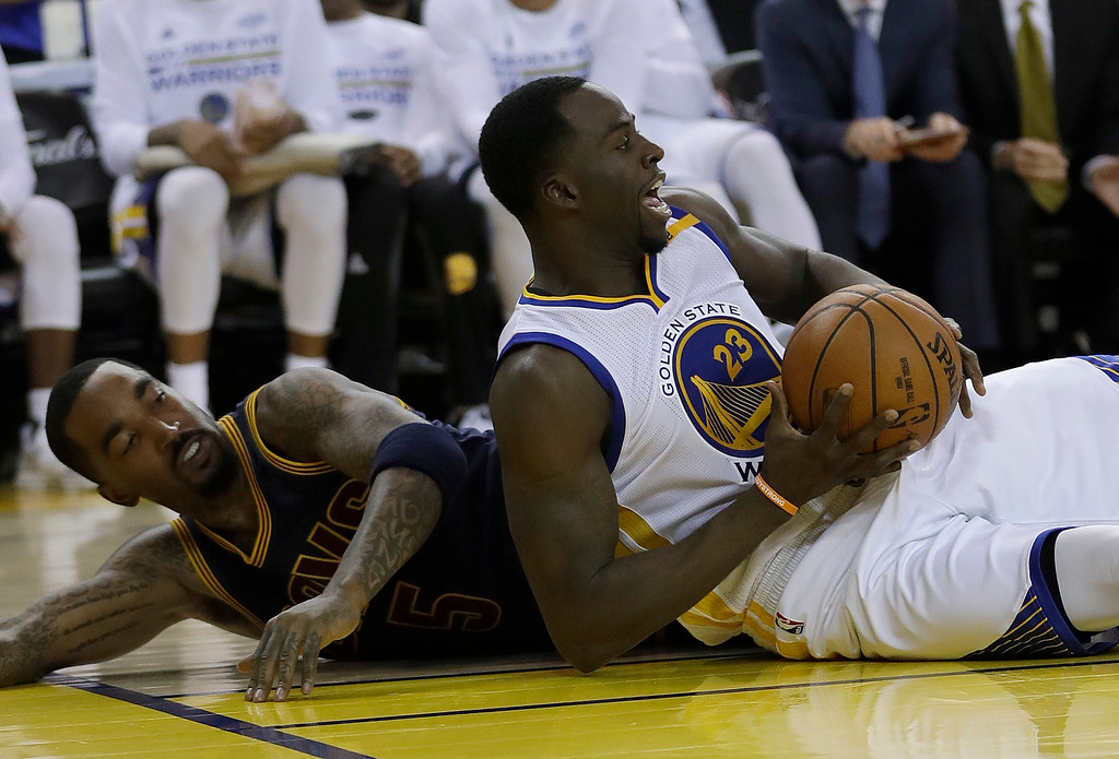 . Golden State Warriors forward Draymond Green (23) controls the ball in front of Cleveland Cavaliers guard J.R. Smith during the second half of Game 1 of basketball\'s NBA Finals in Oakland, Calif., Thursday, June 1, 2017. (AP Photo/Marcio Jose Sanchez)