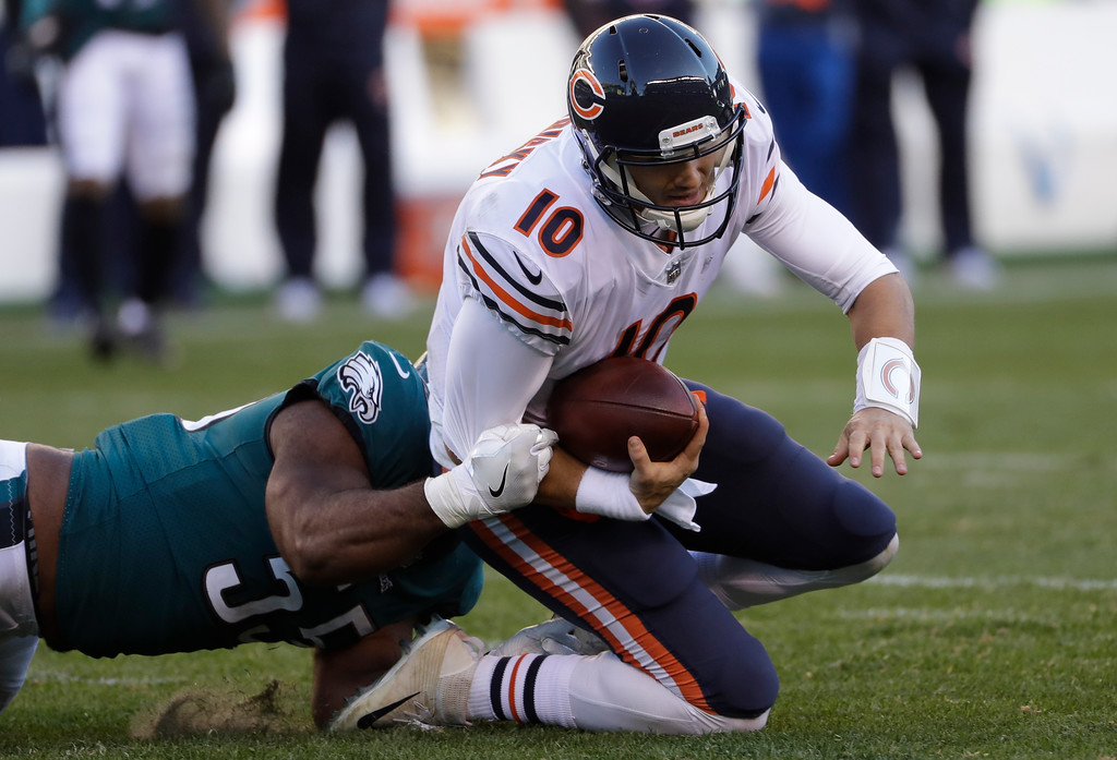 . Chicago Bears\' Mitchell Trubisky, right, is tackled by Philadelphia Eagles\' Brandon Graham during the second half of an NFL football game, Sunday, Nov. 26, 2017, in Philadelphia. (AP Photo/Michael Perez)