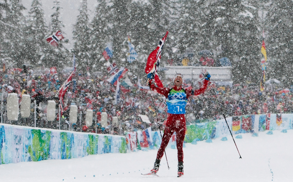 . Norway\'s Ole Einar Bjoerndalen jubilates on his way to the finish line to give Norway the gold medal in the men\'s biathlon 4x7,5 km relay at the Vancouver 2010 Olympics in Whistler, British Columbia, Friday, Feb. 26, 2010. (AP Photo/Andrew Medichini)