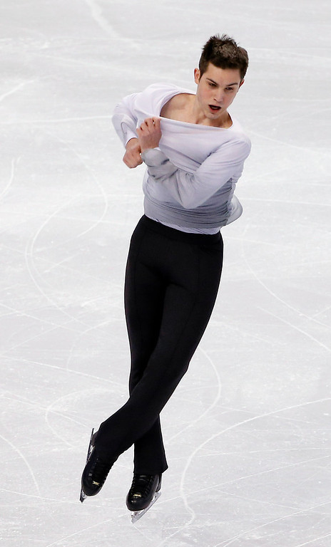 . Joshua Farris competes in the men\'s free skate at the U.S. Figure Skating Championships in Boston, Sunday, Jan. 12, 2014. (AP Photo/Elise Amendola)