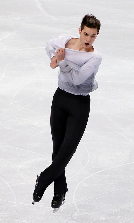 . Joshua Farris competes in the men\'s free skate at the U.S. Figure Skating Championships in Boston, Sunday, Jan. 12, 2014. (AP Photo/Elise Amendola)