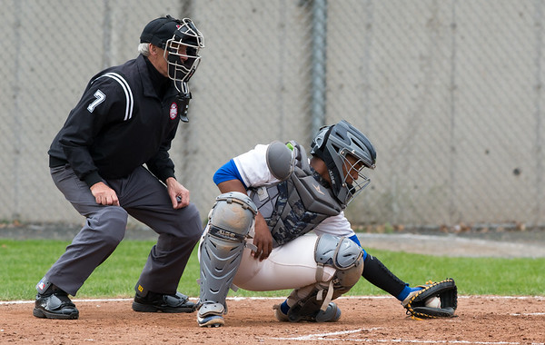 05/02/19 Wesley Bunnell | Staff Plainville baseball defeated Maloney at home on Thursday afternoon. Juan Camacho (24) reaches down for a low inside pitch.