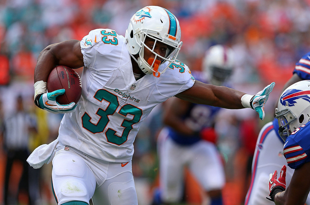 . Daniel Thomas #33 of the Miami Dolphins rushes during a game against the Buffalo Bills at Sun Life Stadium on October 20, 2013 in Miami Gardens, Florida.  (Photo by Mike Ehrmann/Getty Images)