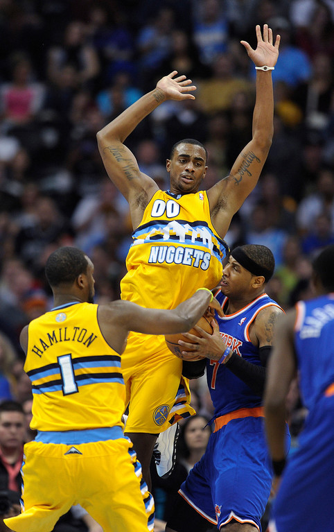 . Denver guard Jordan Hamilton (1) and forward Darrell Arthur (00) double-teamed Carmelo Anthony in the second half.    Photo By Karl Gehring/The Denver Post