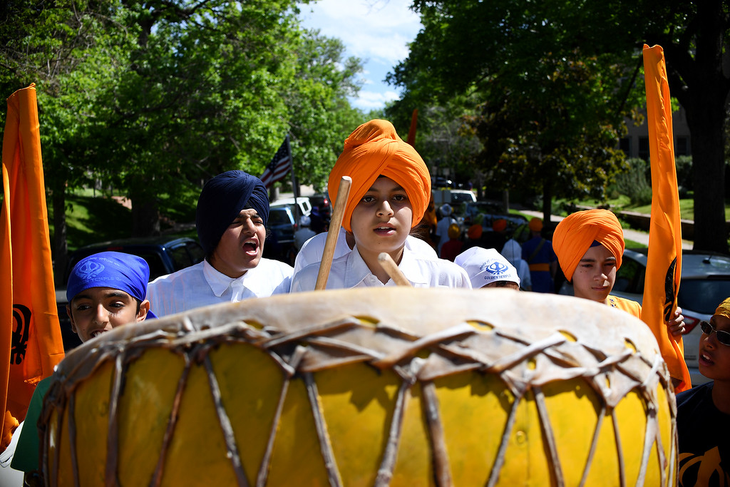 . DENVER, CO - MAY 22: Jasdeep Singh drums as more than 1,000 Sikh followers parade down 17th on Sunday, May 22, 2016. This was Denver\'s first ever Sikh parade. The event was held to celebrate the culture of the growing Sikh population in the area. (Photo by AAron Ontiveroz/The Denver Post)