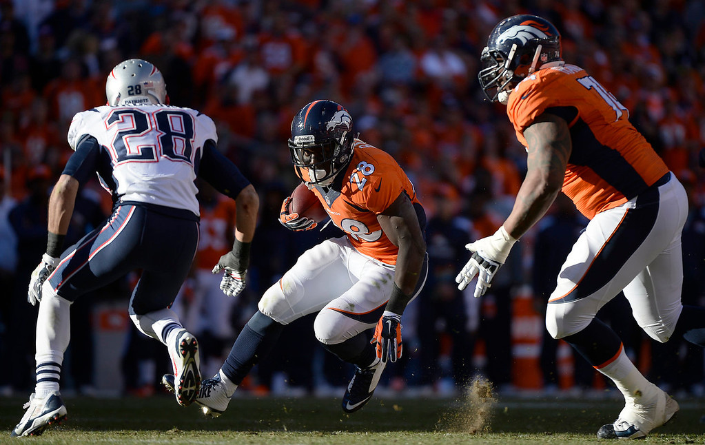 . Denver Broncos running back Montee Ball (28) makes an 8-yard run to and the third quarter. The Denver Broncos take on the New England Patriots in the AFC Championship game at Sports Authority Field at Mile High in Denver on January 19, 2014. (Photo by AAron Ontiveroz/The Denver Post)