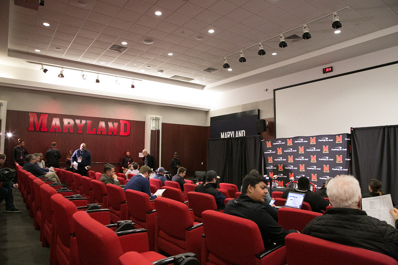 Waiting in Glazer Auditorum for the postgame press conference to start