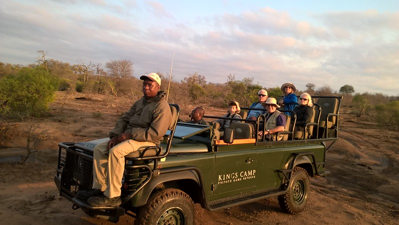 Looking for the animals in two safari jeeps like this. One person is the guide and driver. The person sitting in front is a tracker who aids in pointing out where animals may have gone.