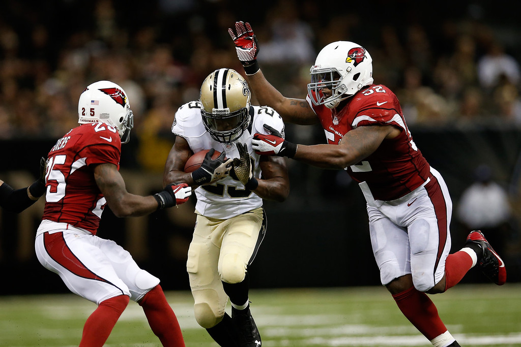 . Khiry Robinson #29 of the New Orleans Saints is tackled by  Jasper Brinkley #52 of the Arizona Cardinals at the Mercedes-Benz Superdome on September 22, 2013 in New Orleans, Louisiana.  (Photo by Chris Graythen/Getty Images)