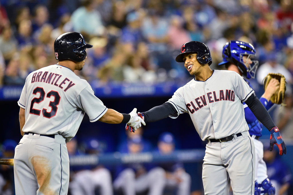 . Cleveland Indians\' Francisco Lindor, front right, celebrates his solo home run against the Toronto Blue Jays with teammate Michael Brantley (23) during third-inning baseball game action in Toronto, Sunday, Sept. 9, 2018. (Frank Gunn)
