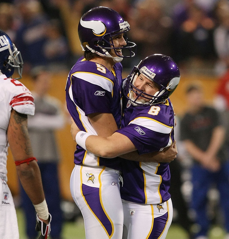 . Minnesota\'s Ryan Longwell and Chris Kluwe celebrate Longwell\'s game winning field goal against the New York Giants on December 28,2008 at the Hubert H. Humphrey Metrodome in Minneapolis, Minnesota. The Vikings defeated the Giants 20-19.  (Photo by Elsa/Getty Images)