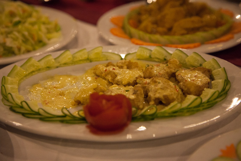 Fried fish with yellow sauce.