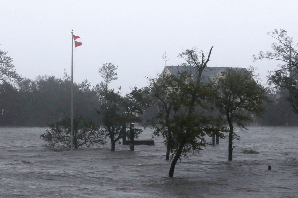 . High winds and storm surge from Hurricane Florence hits Swansboro N.C.,Friday, Sept. 14, 2018. (AP Photo/Tom Copeland)