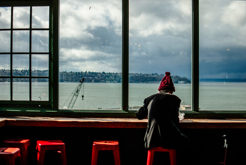seattle man in wondow with red cap.jpg