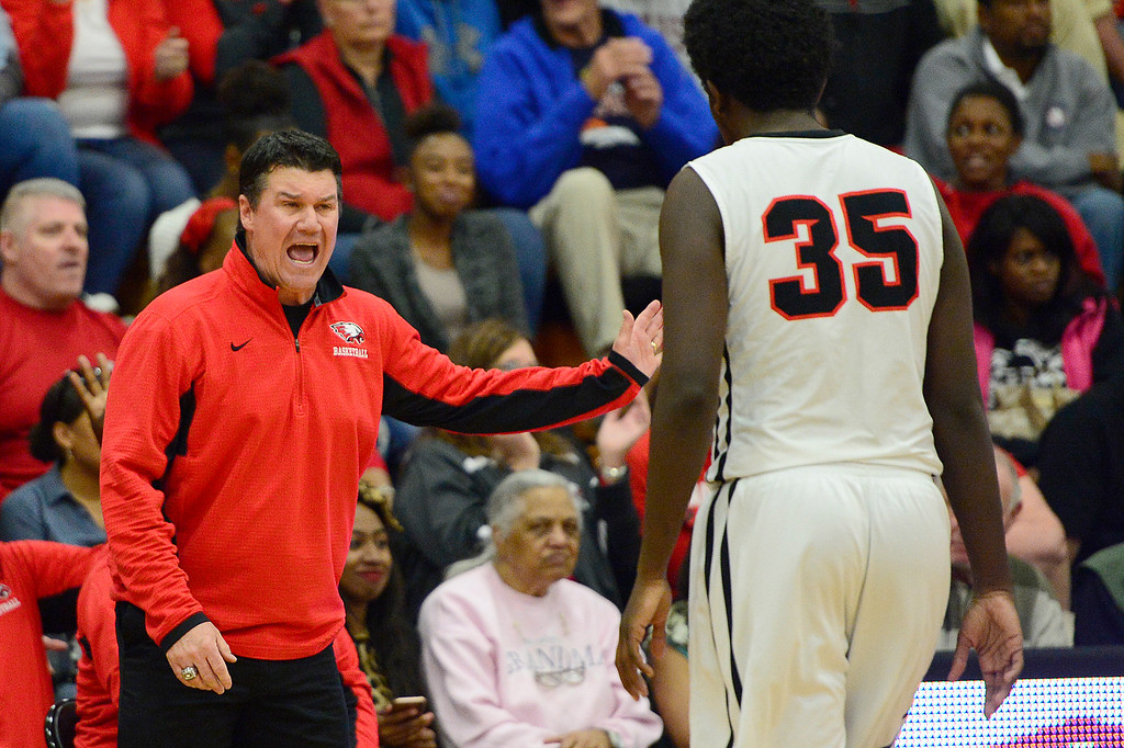 . CENTENNIAL, CO - MARCH 2: Coach John Olander shouts at Josh Walton (35) of Eaglecrest during the fourth quarter at Eaglecrest High School on March 2, 2016 in Centennial, Colorado. Eaglecrest defeated Denver East 56-46. (Photo by Brent Lewis/The Denver Post)
