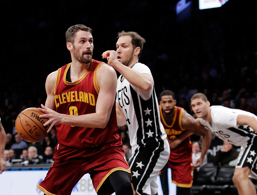 . Cleveland Cavaliers\' Kevin Love (0) is defended by Brooklyn Nets\' Bojan Bogdanovic (44) during the first half of an NBA basketball game Friday, Jan. 6, 2017, in New York. (AP Photo/Frank Franklin II)
