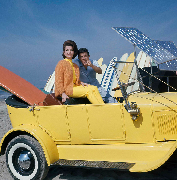 """. Singer Frankie Avalon with actress Annette Funicello on Malibu Beach, during filming of \""""Beauty Party,\"""" in California in 1963. (AP Photo)"""