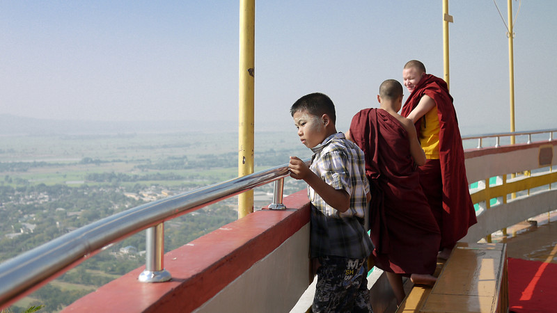 Enjoying the sweeping views of the city from Mandalay Hill, Burma.