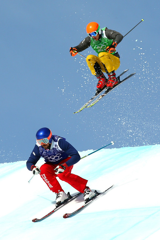 . John Teller of the United States leads from Daniel Bohnacker of Germany during the Freestyle Skiing Men\'s Ski Cross 1/8 Finals on day 13 of the 2014 Sochi Winter Olympic at Rosa Khutor Extreme Park on February 20, 2014 in Sochi, Russia.  (Photo by Cameron Spencer/Getty Images)