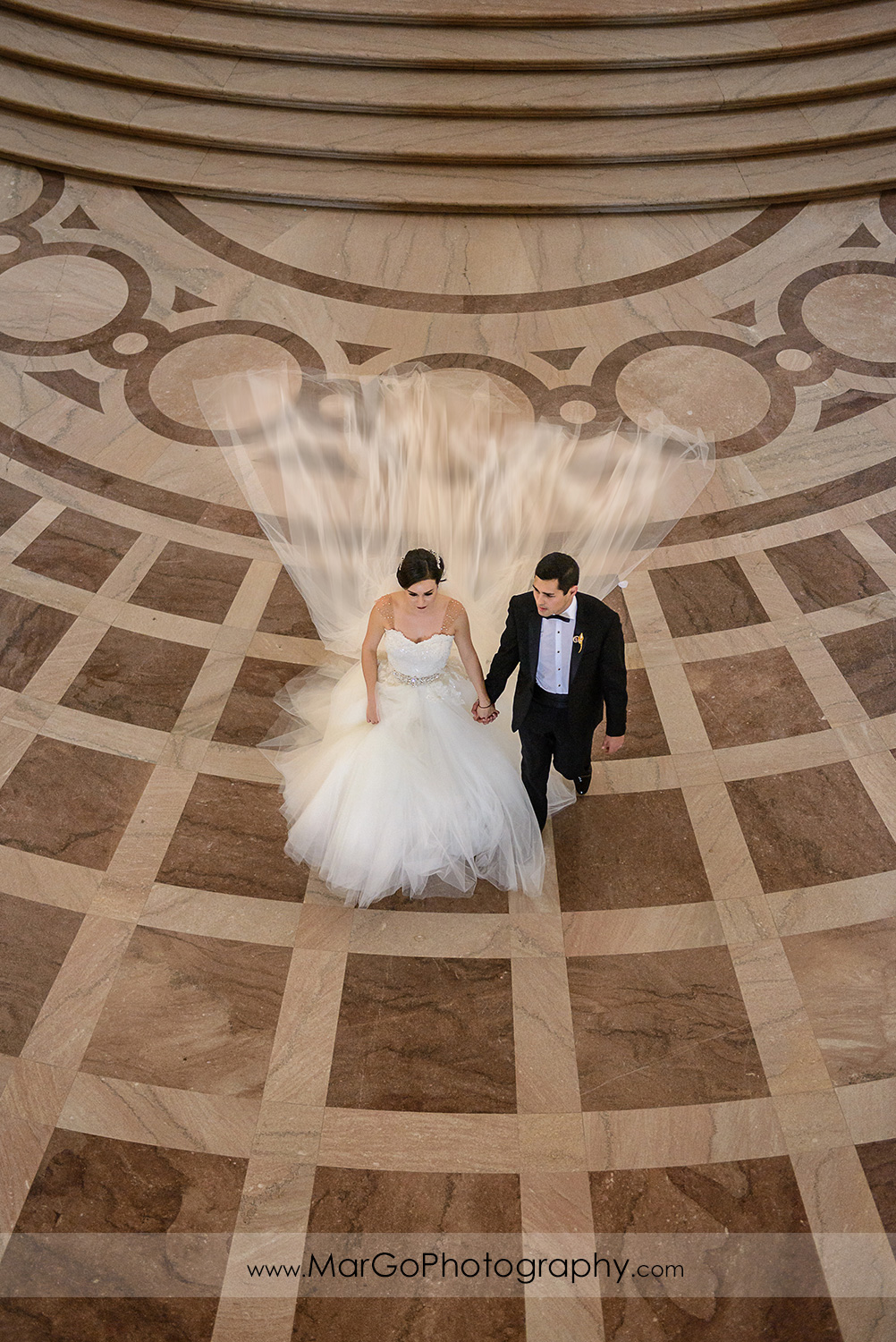 bride and groom leaving San Francisco City Hall