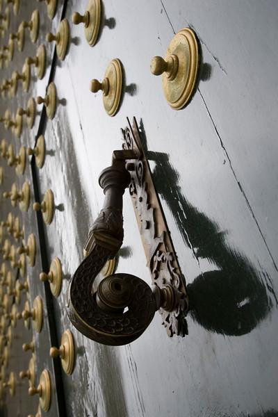 Detail of the  doorknocker of the main doorway of El Escorial monastery, Spain