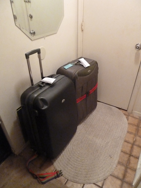 "Traditional ""suitcases waiting by the front door"" photo."