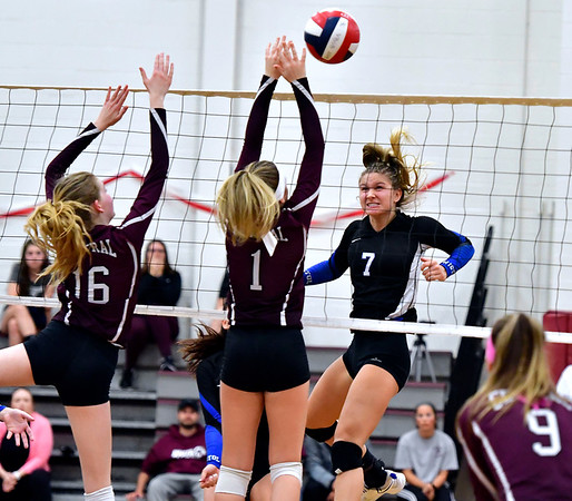 10/30/2019 Mike Orazzi | StaffrBristol Central's Kayla St. Onge (16) and Jadyn Bauer (1) and Bristol Eastern's Zoe Lowe (7) during Wednesday night's volleyball match at Bristol Central.