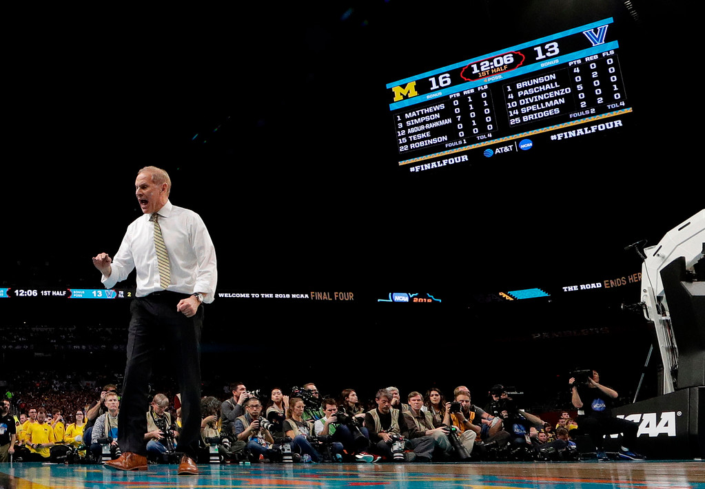 . Michigan head coach John Beilein directs his team during the first half against Villanova in the championship game of the Final Four NCAA college basketball tournament, Monday, April 2, 2018, in San Antonio. (AP Photo/Eric Gay)