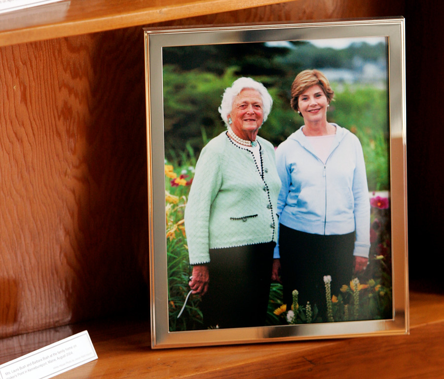 . A portrait of former first lady Barbara Bush, left, and her daughter-in-law, first lady Laura Bush, right, is seen on a shelf in the family room in the  childhood home of President George W. Bush in Midland, Texas, Monday, April 10, 2006. The home was built in 1939 and had been added onto before they moved in. The Bushes occupied the 1,547 square foot home from 1951 to the end of 1955. (AP Photo/Tony Gutierrez)